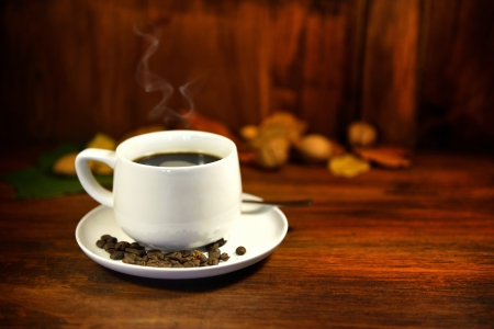 A steaming cup of coffee. photo