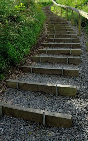 Steep stairs on a footpath Stock Photo