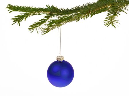 Blue Christmas decorations hanging from a pine branch - isolated on white background