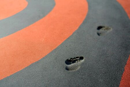 Footprints on a racetrack photo