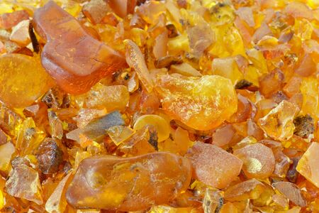A bunch of different sized pieces of amber Stock Photo