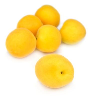 Fresh apricots isolated over white background Stock Photo