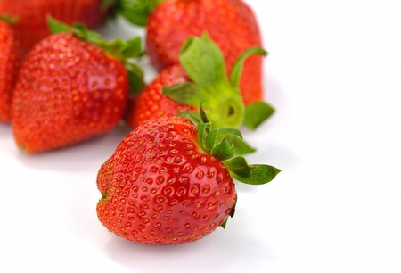 Isolated strawberries over white background