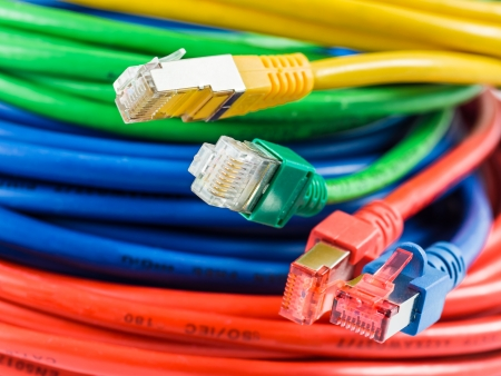 network cable: Colorful network cable with RJ45 connectors Stock Photo