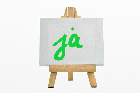 affirm: An easel with sign YES