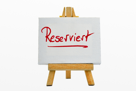An easel with sign Reserviert Reserved Stock Photo