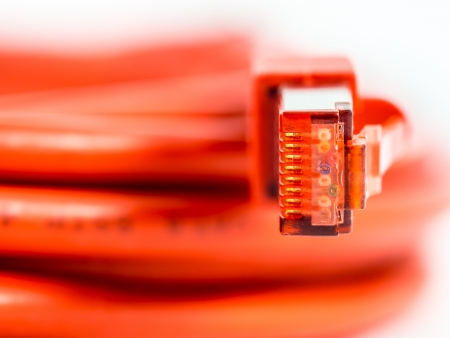 network cable: Orange network cable with RJ45 connector