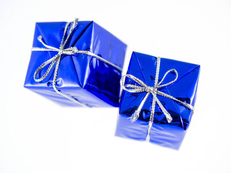 Blue Christmas gifts isolated over white background Standard-Bild
