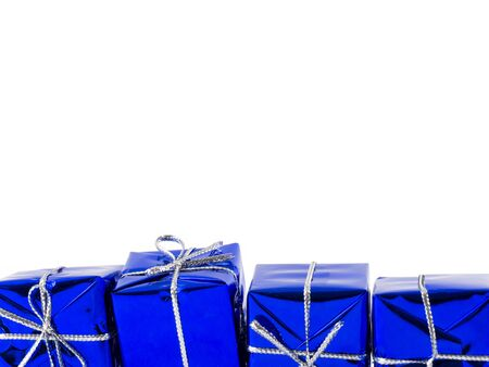 Blue Christmas gifts isolated over white background Stock Photo - 22717734