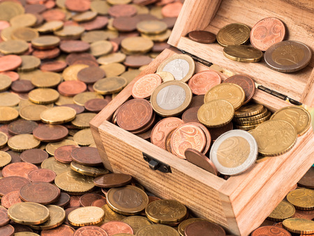 thrift box: A treasure chest with a bunch of Euro coins and cents Stock Photo
