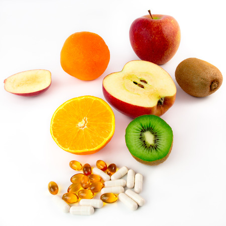 Various vitamin-rich fruits and vitamin tablets