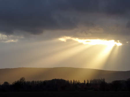 A ray of sunshine breaks through the dark clouds Stock Photo