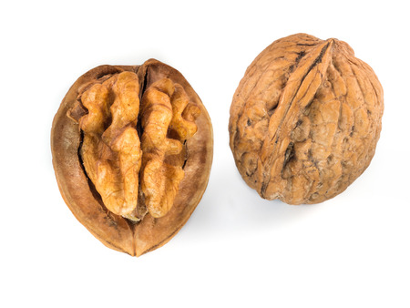 Opened and whole walnuts