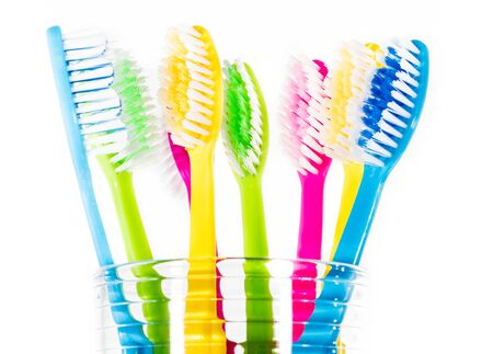 dental prophylaxis: Colourful toothbrushes in a glass Stock Photo