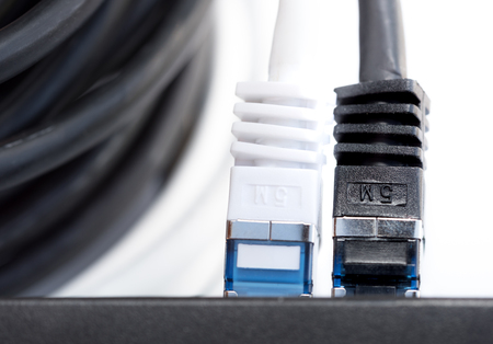 network cables: Network cables connected to a switch Stock Photo