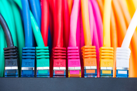 Colorful network cables connected to a switch Stock Photo