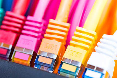 gigabit: Colorful network cables connected to a switch Stock Photo