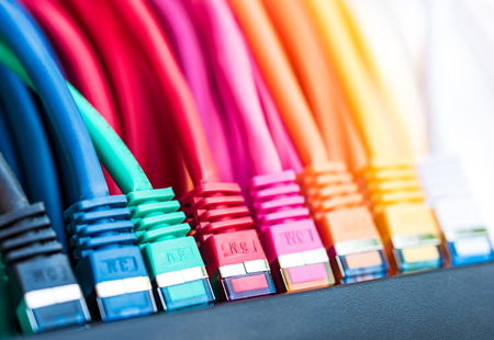 Colorful network cables connected to a switch Standard-Bild