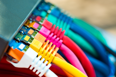 Colorful network cables connected to a switch Banque d'images