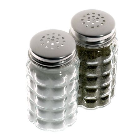 Salt and pepper shakers on white background.