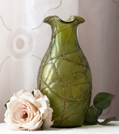 vase art noveau with artifical rose photo
