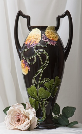 amphora art noveau with artifical rose photo