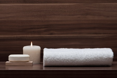 arrangement of soap, towel and candle