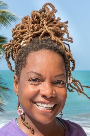 Close Up Portrait of Laughing Beautiful Black Woman at Gorgeous Beach