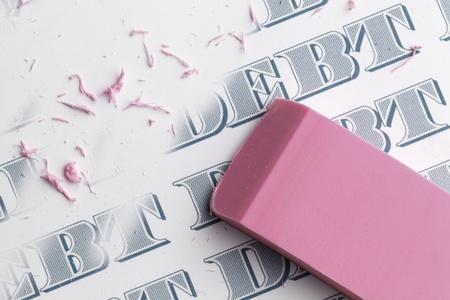 Pink eraser erasing multiple debts written in money font.