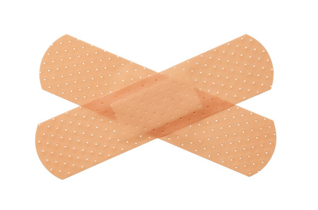 criss: Bandages criss crossing isolated on a white background.
