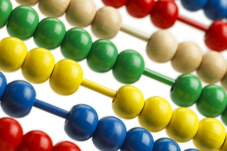 sorted: Colored Abacus Beads Sorted Close Up View. Stock Photo