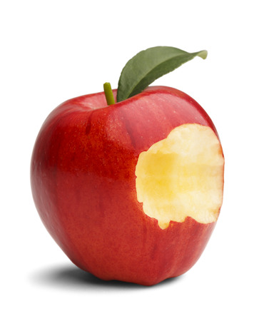 missing: Red apple with green leaf missing a bite isolated on a white background.