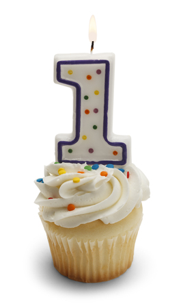 first birthday: Cupcake with a Number One Candle Isolated on White Background.