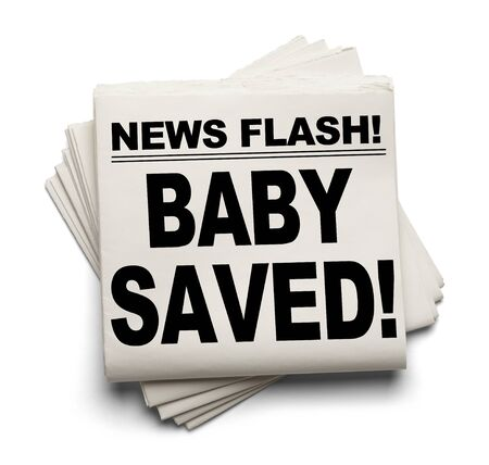rescued: News Flash Baby Saved! News Paper Isolated on White Background. Stock Photo