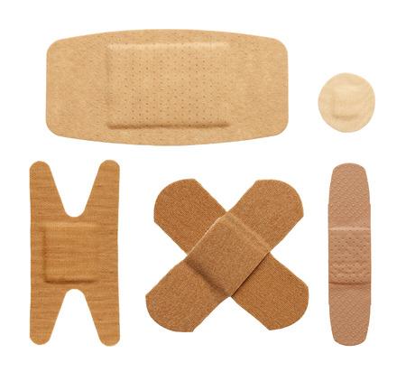adhesive bandage: Various bandage shapes sizes and colors isolated on a white background. Stock Photo