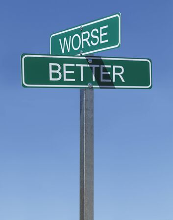 worse: Green Street Signs Better and Worse on Metal Pole With Blue Sky Background.