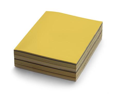 directorio telefonico: Agenda amarillo con copia espacio aislado en el fondo blanco. Foto de archivo