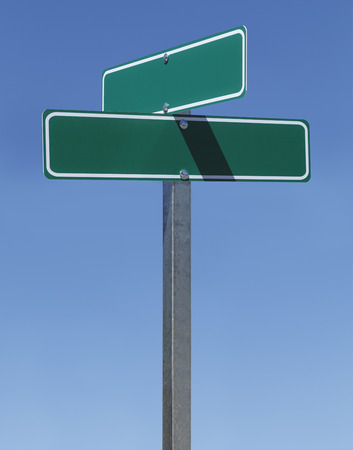 green street sign: Two Green Street Signs on Metal Pole With Copy Space with Blue Sky.