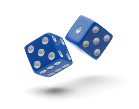 Two Dice Rolling through the Air Isolated on White Background with Shawdows.