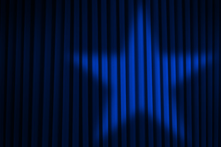 Blue Stage Curtain With Star Spotlight.