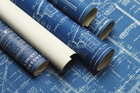 project planning: Rolled House Blueprints and Construction Plans. Stock Photo
