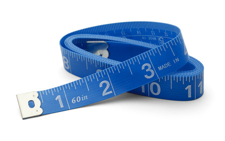 Sewing Tape measure rolled up Isolated on White Back Ground. photo