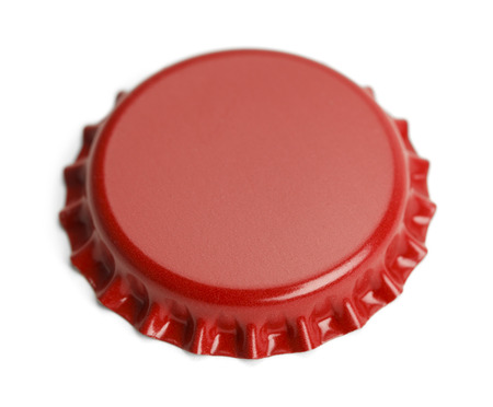 food photography: Red Metal Bottle Cap With Copy Space Isolated on White Background.