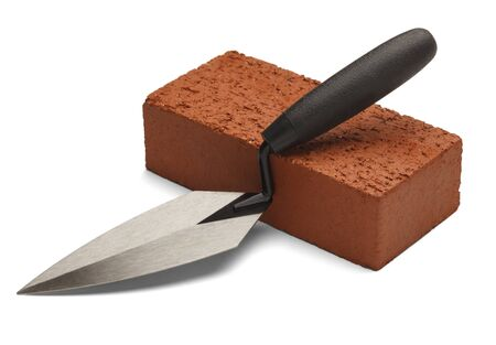 clay brick: Single red brick with trowel isolated on white background.