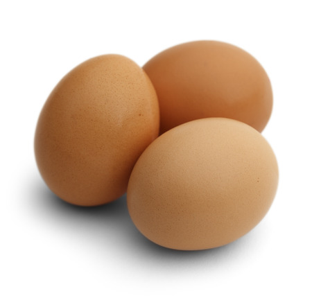 Three Brown Chicken Eggs Isolated on White Background.