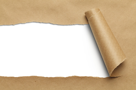 torn edge: Brown Package Paper Rolled Up with White Background. Stock Photo