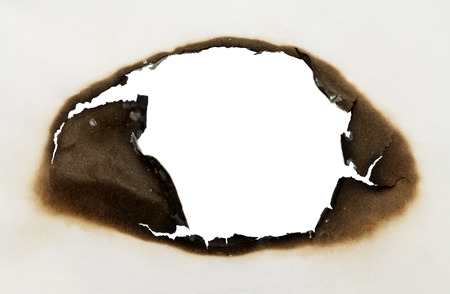 Piece of Paper with Burnt Hole in Oval Shape with White Background.