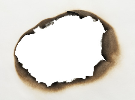 oval shape: Piece of Paper with Burnt Hole in Oval Shape with White Background.