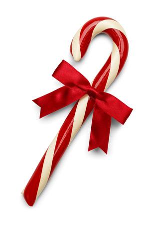 Kerstmis Candycane met rode strik op een witte achtergrond. Stockfoto