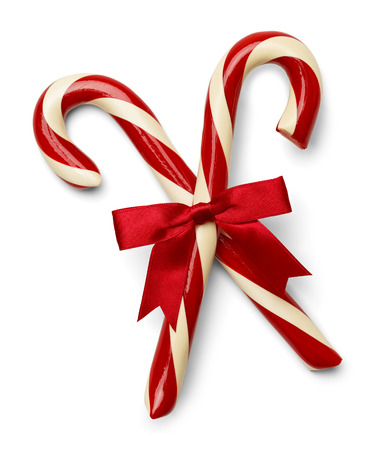 Two Candycanes Crossed with Red Ribbon Isolated on White Background.